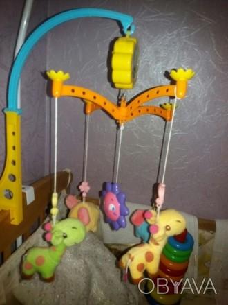 Продам почти новый музыкальный мобиль на кроватку, шикарные цвета и яркие мягкие. Киев, Киевская область. фото 1