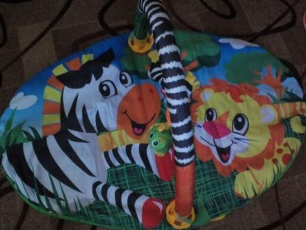 Продам коврик удобной овальной формы с одной дугой для размещения игрушек,дуга с. Тростянець, Сумська область. фото 4