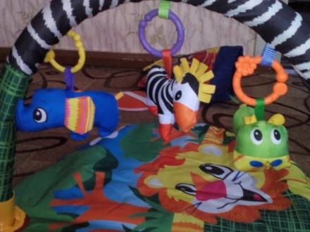 Продам коврик удобной овальной формы с одной дугой для размещения игрушек,дуга с. Тростянець, Сумська область. фото 3