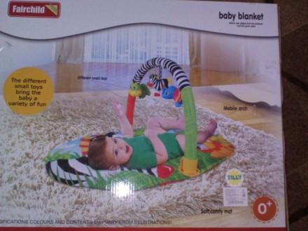 Продам коврик удобной овальной формы с одной дугой для размещения игрушек,дуга с. Тростянець, Сумська область. фото 2