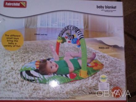 Продам коврик удобной овальной формы с одной дугой для размещения игрушек,дуга с. Тростянець, Сумська область. фото 1