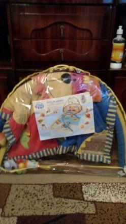 Продам красивый фирменный развивающий коврик с погремушками Canpol Babies ( Поль. Макіївка, Донецька область. фото 2