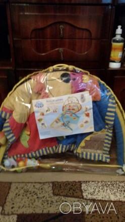 Продам красивый фирменный развивающий коврик с погремушками Canpol Babies ( Поль. Макіївка, Донецька область. фото 1