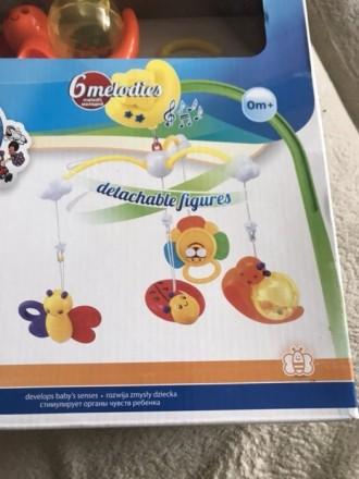 Продам детскую мобиль, 4 пластмассовые съемные игрушки, 6 мелодий переключаются . Прилуки, Черниговская область. фото 2