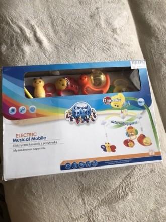 Продам детскую мобиль, 4 пластмассовые съемные игрушки, 6 мелодий переключаются . Прилуки, Черниговская область. фото 4
