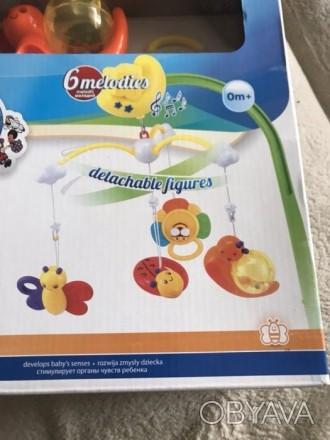 Продам детскую мобиль, 4 пластмассовые съемные игрушки, 6 мелодий переключаются . Прилуки, Черниговская область. фото 1