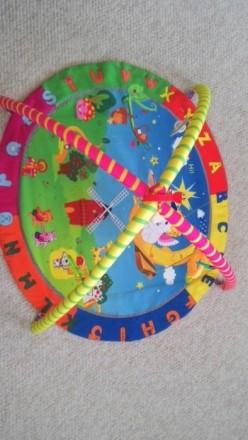 Прикольный коврик в отличном состоянии с игрушками. В центре игрушка с вибрацией. Овидиополь, Одесская область. фото 3