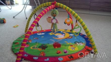 Прикольный коврик в отличном состоянии с игрушками. В центре игрушка с вибрацией. Овидиополь, Одесская область. фото 1