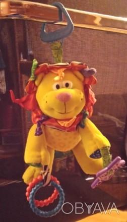 Развивающиеся игрушка лев. Можно использовать как подвеску для кроватки или коля. Киев, Киевская область. фото 1