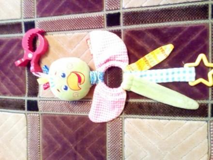 Продаю нашу любимую подвеску в краватку,каляску попугайчика.игрушка в состоянии . Баришівка, Київська область. фото 6