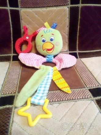 Продаю нашу любимую подвеску в краватку,каляску попугайчика.игрушка в состоянии . Баришівка, Київська область. фото 1