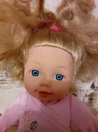 Красивая куколка с милым личиком,и красивыми густыми волосами.Нажимая на живот,з. Київ, Київська область. фото 4
