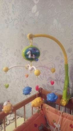 Мобиль на детскую кроватку, игрушки по типу погремушок (торохтят), играет приятн. Київ, Київська область. фото 3