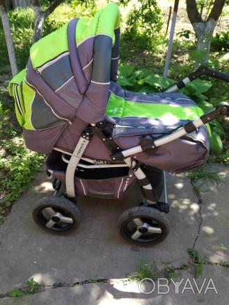 Детская коляска,зима -лето,в хорошем состоянииЦвет яркий не выгоревший.Колеса не. Запоріжжя, Запорізька область. фото 1