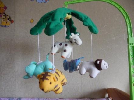 Закрепив игрушку на кроватку, малыш сможет засыпать под мерное вращение игрушек . Запоріжжя, Запорізька область. фото 2