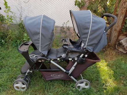 Продам коляску для двойни и погодок Graco Stadium. Новая Каховка. фото 1