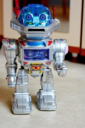 Игрушка робот, стреляет дисками, танцует, звук (англ), свет. Харьков. фото 1