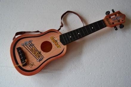 детская гитара пластиковая бу. Киев. фото 1