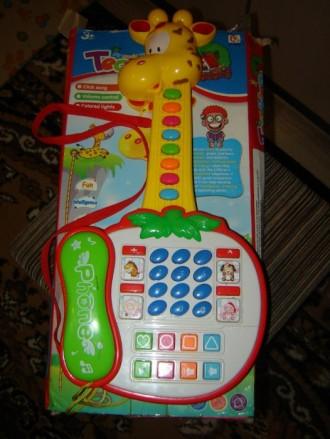 Музыкальная игрушка гитара. Запорожье. фото 1