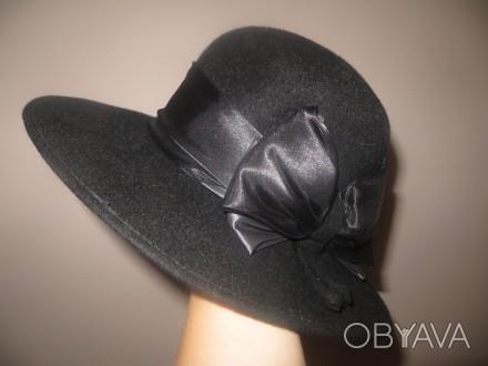 Продам новую черную шляпу с широкими полами с бантиком. Очень красивая. Полтава, Полтавская область. фото 1